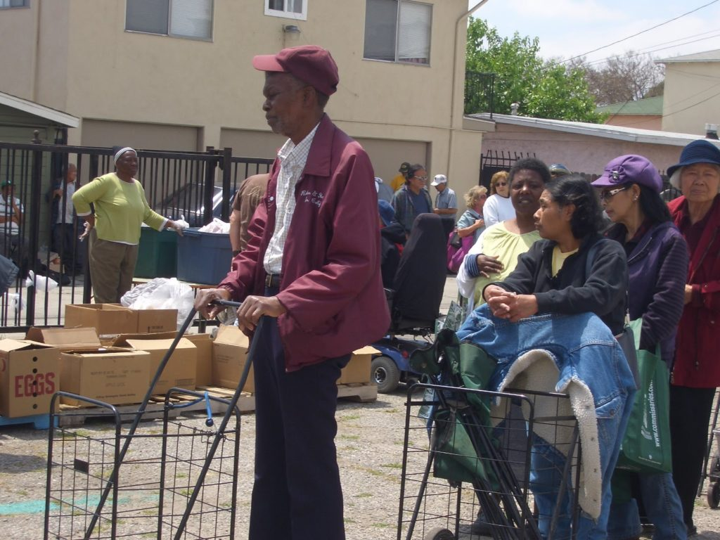 Mama Jessie Distributing Food at P.I.M. Long Beach